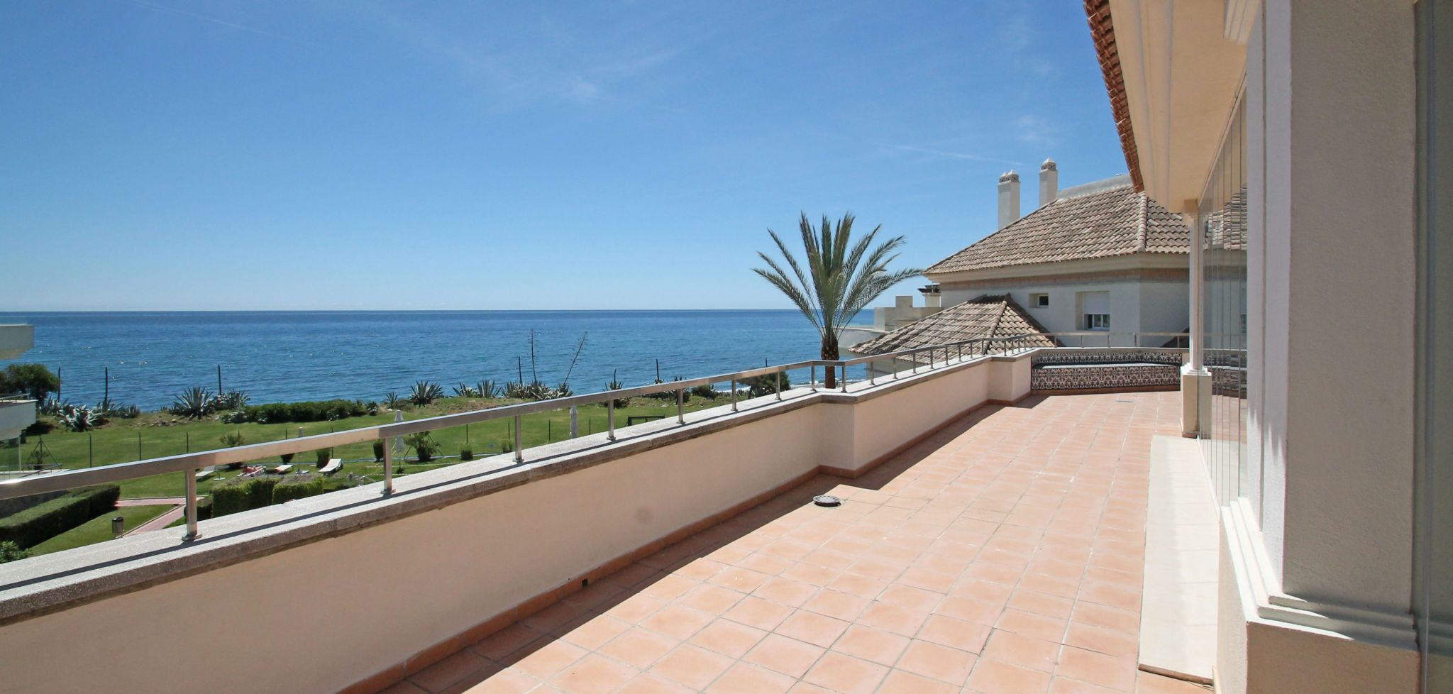 Beachfront three bedroom duplex penthouse with sea views, New Golden Mile